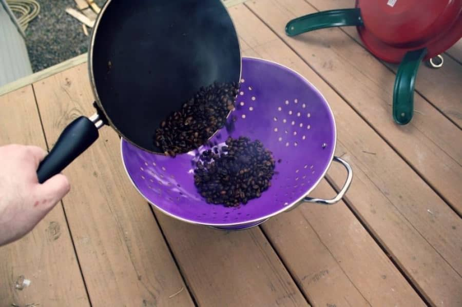 Cool roasted coffee beans in a cooled colander