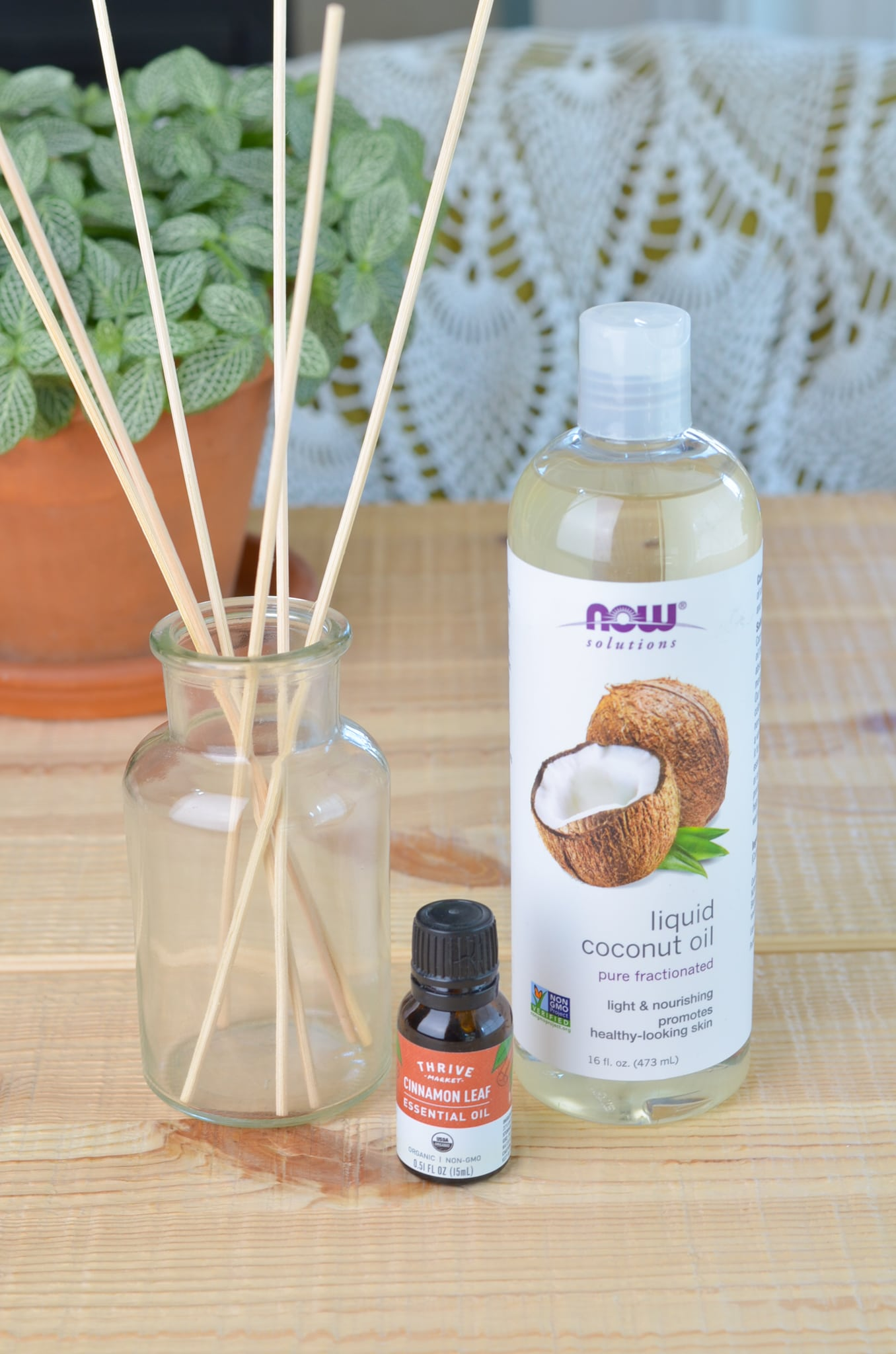 Ingredients to make a homemade cinnamon reed diffuser